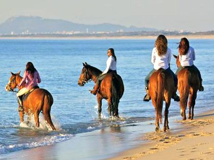 Passeio de cavalo na praia